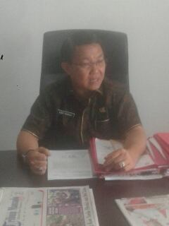 Dr Denny Mangalah M.Si
