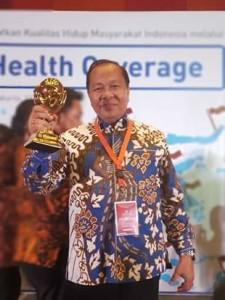 Universal Health Coverage ,JKN-KIS Award 2018,maximiliaan J Lomban