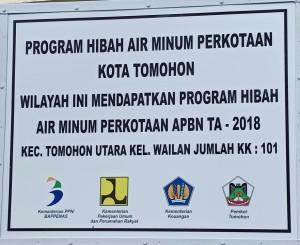 Papan Proyek Hibah Air Bersih MBR di Kantor Lurah Wailan