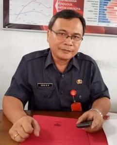KTP-el, KTP-el minahasa, Drs Riviva Maringkah M.Si