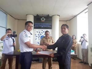 Sertijab Kepala Dinas Kominfo dari Hengkie Yusenimus Supit SIP kepada Jusak TS Pandeirot SPd MM