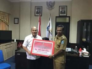 Pemkab dan Masyarakat Minahasa Donasikan 300 Juta Untuk Korban Bencana Sentani Jayapura