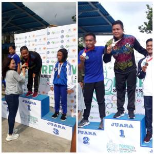 Chintya Rungkat dan Christofel Masengi yang baru saja meraih medali emas dari Cabang Selam