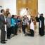 Jadi Orang Tua Baptis, JFE dan MJLW Beribadah di GMIM Efrata Kamasi-Kamasi Satu