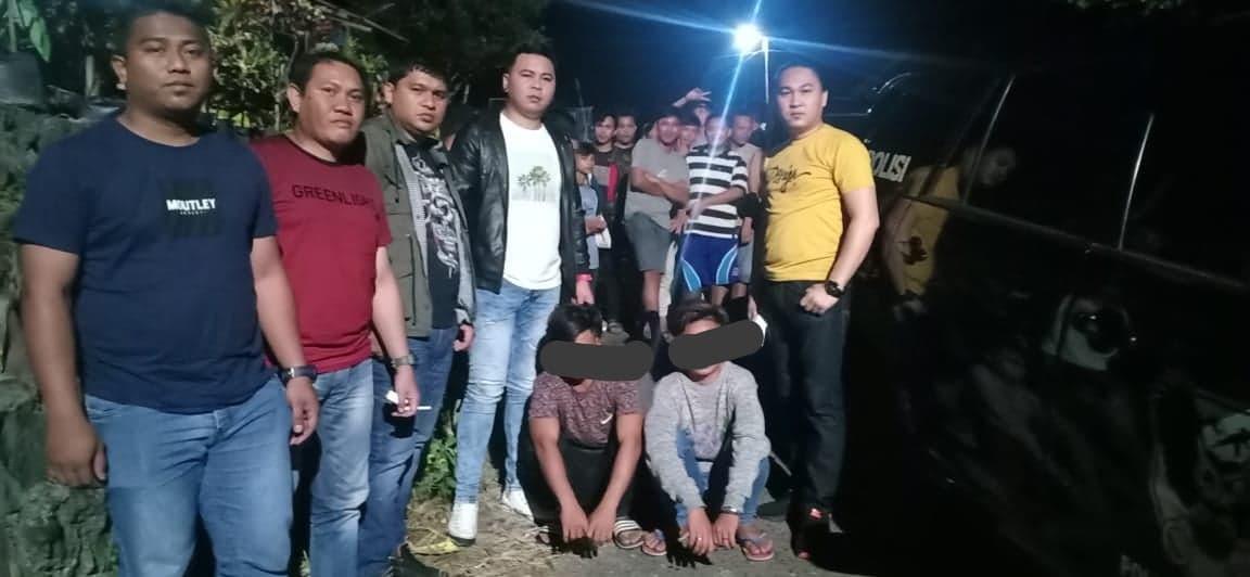 Tim URC Totosik Polres Tomohon dan dua pelaku keributan yang diamankan