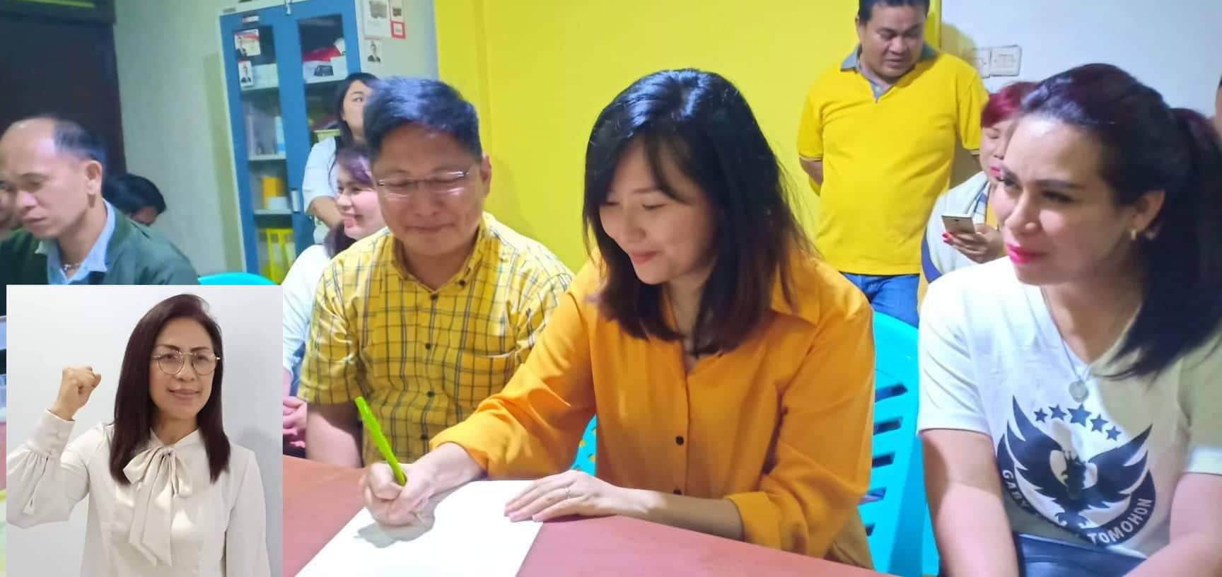 Jilly Gabriella Eman SE MM saat mendaftar sebagai bakal calon di Partai Golkar. (inzet Ir Miky JL Wenur MAP)