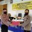 Kapolres Minahasa Serahkan THR Idul Fitri kepada Personel